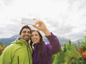 hikers taking selfie wtih cell phone
